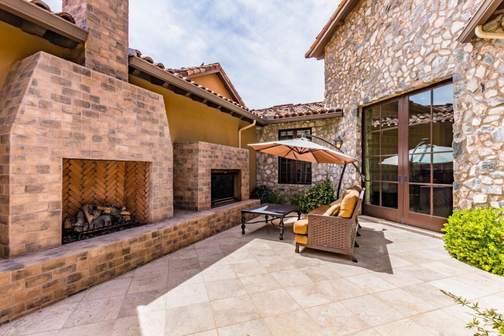 Private courtyard with fireplace and grill
