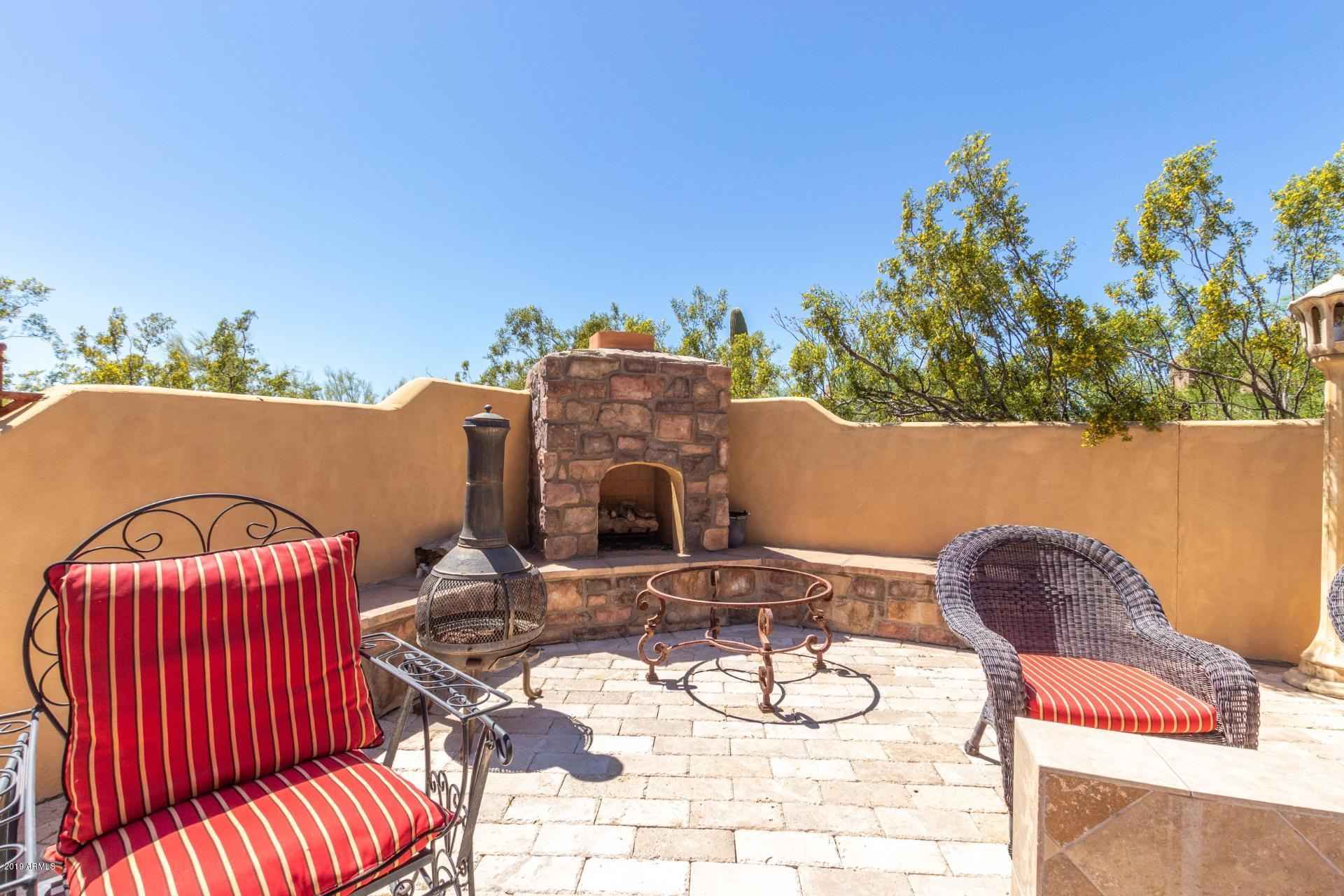 Candlewood Estates home outdoor patio fireplace